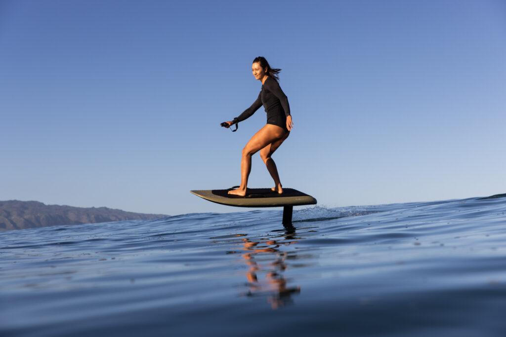 A woman riding a Fliteboard